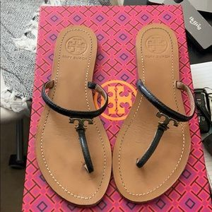 Tory Burch black patent flip flops / sandals